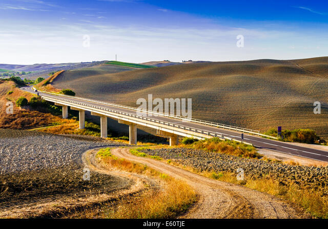 Bridge and hills in a summer day in Crete Senesi in Tuscany, Italy - Stock-Bilder