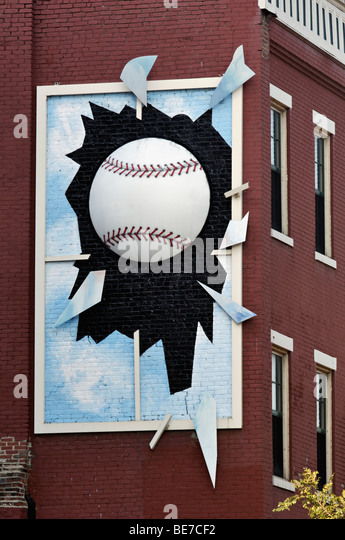 Funny Sign of Three Diminsional Baseball Breaking Window on Side of Building in Louisville, Kentucky - Stock Image