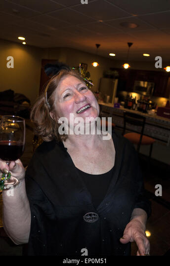 Ecstatic mature adult female enjoying a glorious moment at her Academy Award Party. St Louis Park Minnesota MN USA - Stock Image