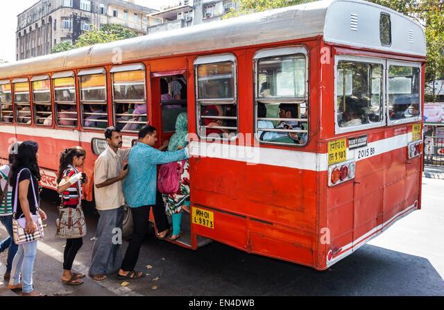 Mumbai India Asian Churchgate Veer Nariman Road BEST bus public transportation man woman getting on passengers riders - Stock Image