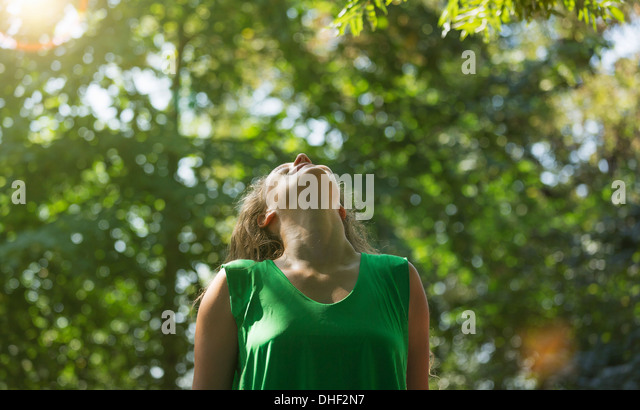 Teenage girl wearing green top looking up, Prague, Czech Republic - Stock-Bilder