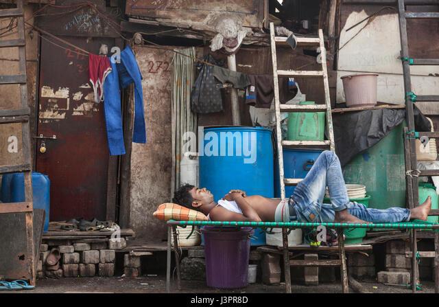 Man napping during the day, Mumbai - Stock Image