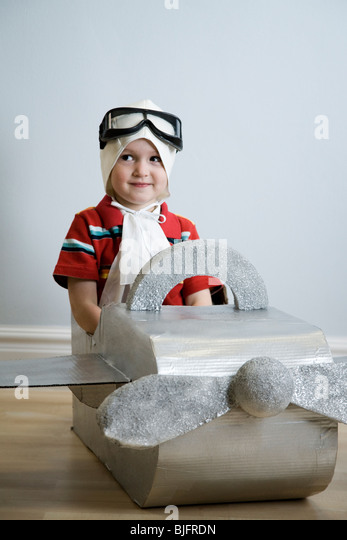 little boy playing dress up - Stock Image