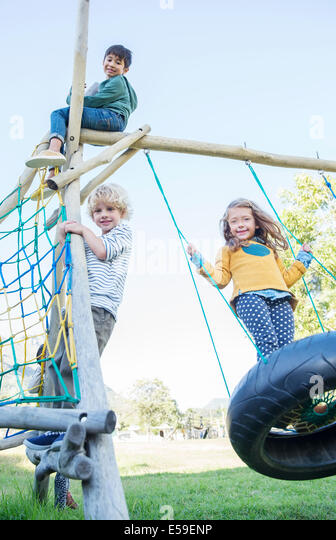Children playing on play structure - Stock Image