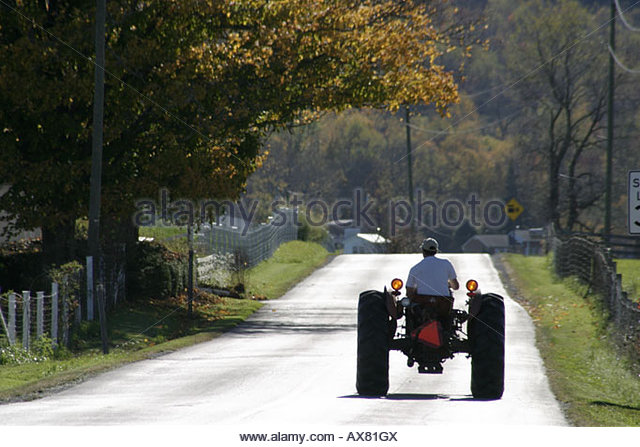 West Virginia Frankford rural road tractor - Stock Image