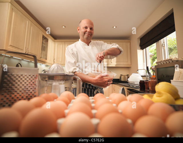 Pastry chef baking at home - Stock Image