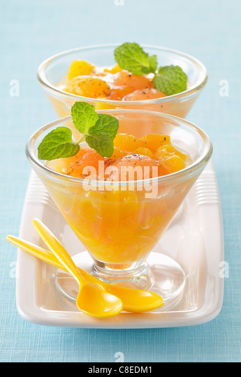 Peach,pear and melon fruit salad with Muscat - Stock Image