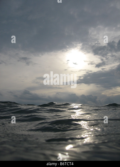 View of water and sky looking up from surface - Stock Image