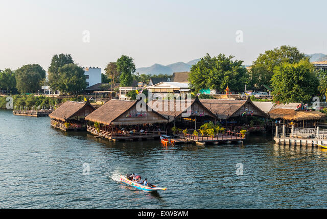 Longtail boat in front of floating houses, River Kwai, Kanchanaburi Province, Central Thailand, Thailand - Stock Image