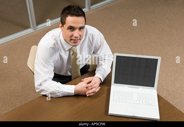 Bank manager with laptop - Stock Image