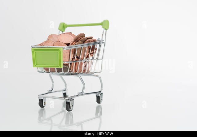 Penny / 1p coins in shopping trolley. Representing UK consumer spending power and high street sales. - Stock Image