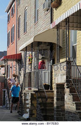 Baltimore Maryland Little Italy ethnic neighborhood working class community row house townhouse man woman neighbor - Stock Image