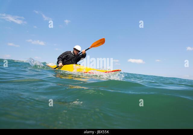 Man paddling kayak at sea, Las Huacas, Guanacaste, Costa Rica, Central America - Stock-Bilder