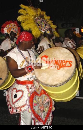 BAHAMAS Junkanoo Parade Man playing drum - Stock Image