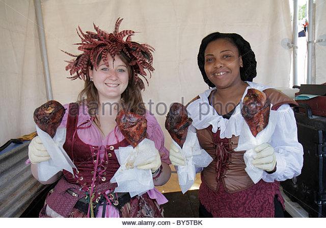 Deerfield Beach Florida Quiet Waters Park Florida Renaissance Festival costume turkey legs food vendor Black woman - Stock Image