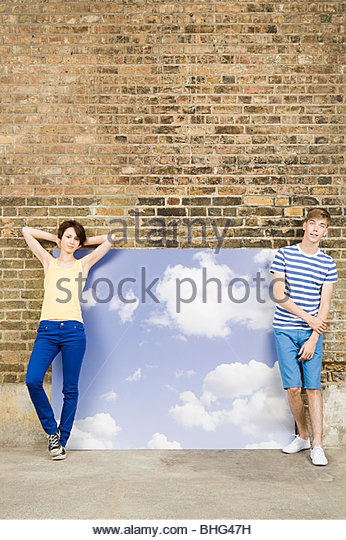 Young couple with sky and cloud backdrop - Stock Image