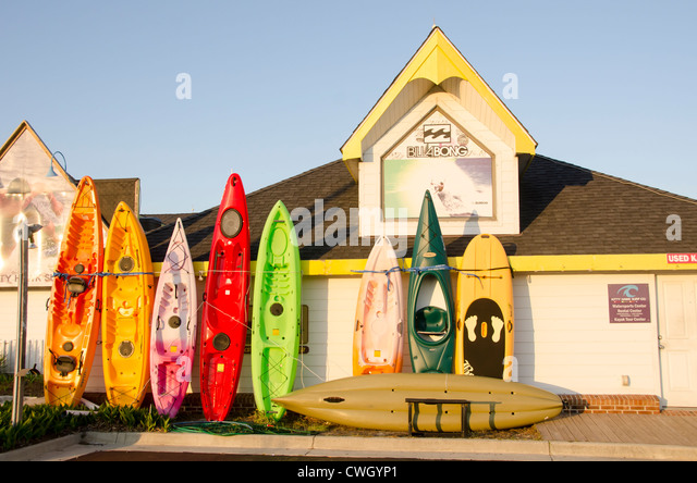 Kitty Hawk North Carolina kayak rental with colorful kayaks against store exterior on Outer Banks - Stock Image