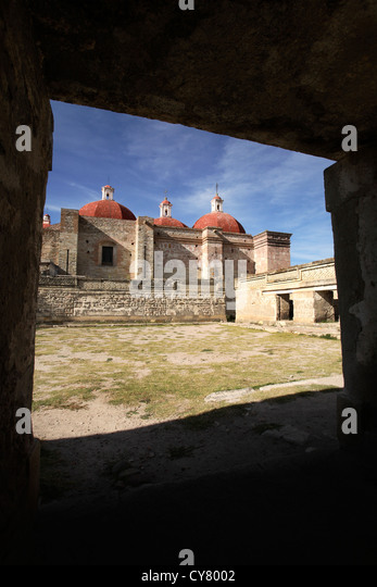 Domes and ruins at the Mitla, Oaxaca, Mexico archaeology site seen through a window. - Stock Image