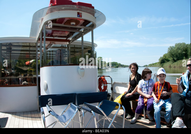 Children aboard a Ferry Tour along the Arno River in the San Rossore National Park in the province of Pisa, Italy - Stock Image
