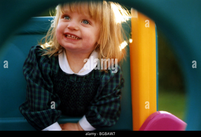 Photograph of happy girl playing nursery play time healthy smile - Stock-Bilder