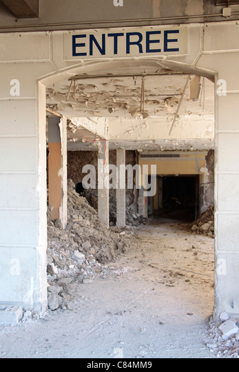 Obsolete entrance with heaps of rubble - Stock Image