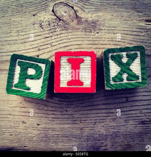 It's a photo of 3 wood cubes toy with letters that form the word PIX - Stock Image
