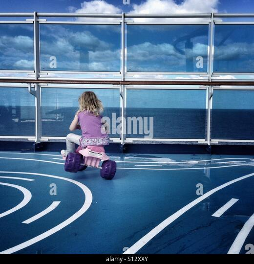 Cruise ship activities for kids can include tricycle race tracks. - Stock Image