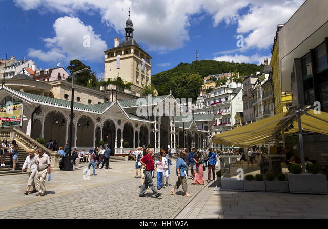 People walk on streets of spa town Karlovy Vary on July 3, 2016 in Karlovy Vary, Czech republic. - Stock-Bilder
