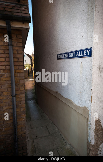 The very narrow Squeeze Gut Alley in Whitstable, Kent, UK - Stock Image