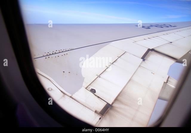 China Shanghai Changning District Hongqiao Airport SHA flight to Beijing China Air onboard window seat view wing - Stock Image