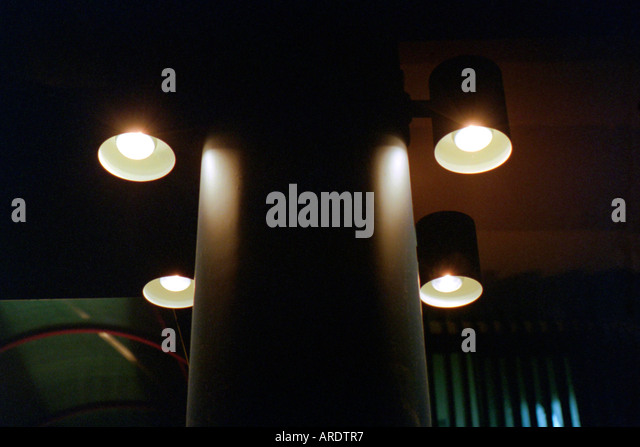 Four Spot Lights around a concrete column - Stock Image