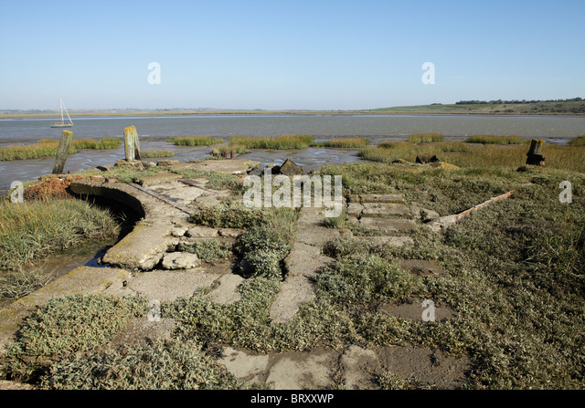Ruins of the jetties on the river Swale used for the loading of Gunpowder and TNT near Uplees in Kent. - Stock Image
