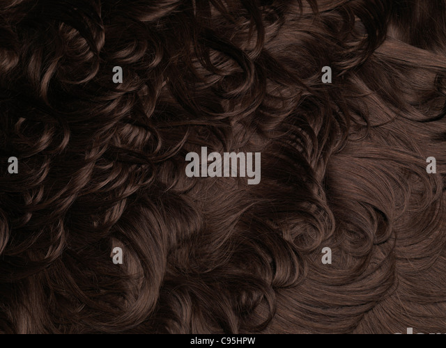 Brown natural human hair extensions background texture - Stock-Bilder