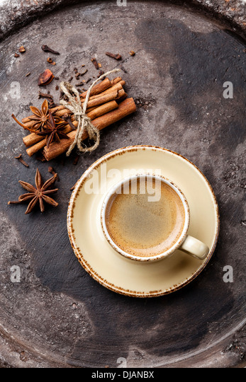 Coffee with spices on dark background - Stock Image