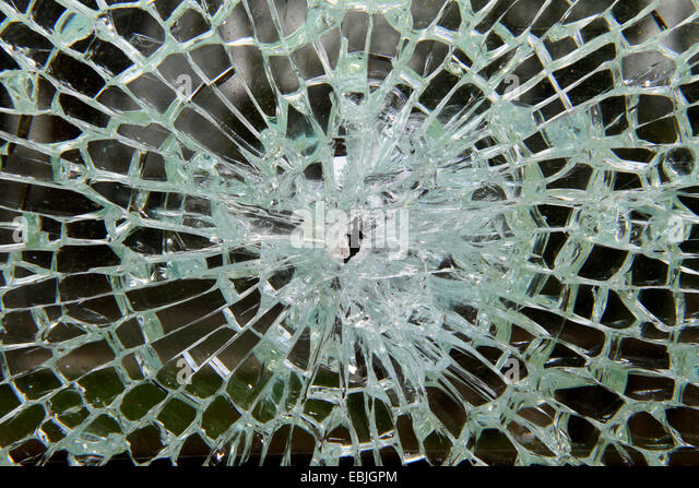 security glass broke after a forceful impact - Stock Image