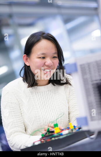 A woman engineer working with electronics - Stock Image