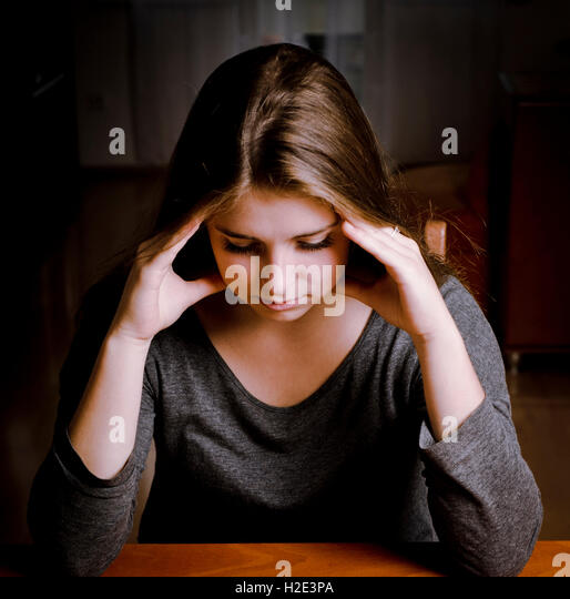 girl with an headache or depressed - Stock Image