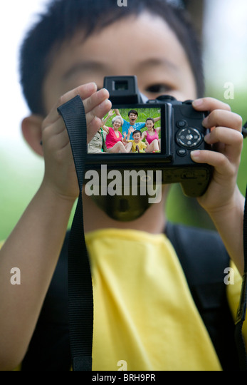 Little boy taking a photo of himself - Stock Image