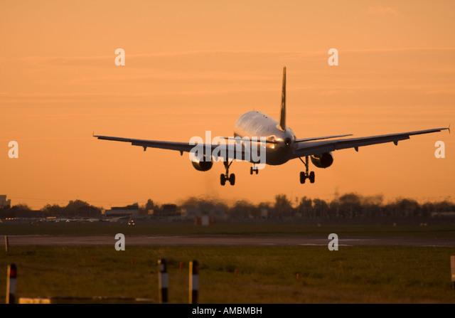 Airplane landing at airport - Stock Image