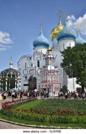 Many pilgrims and tourists gathered in the main square of the Cathedral of the Holy Trinity St. Sergius Lavra. - Stock Image