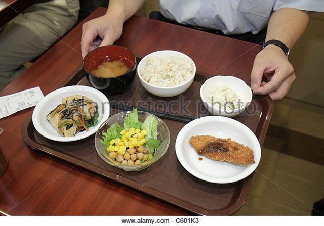 Japan Tokyo Shinjuku Shinjuku NS Building restaurant buffet tray food bowls soup - Stock Image