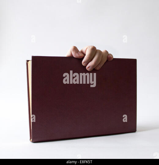 Hand Holding A Book - Stock Image