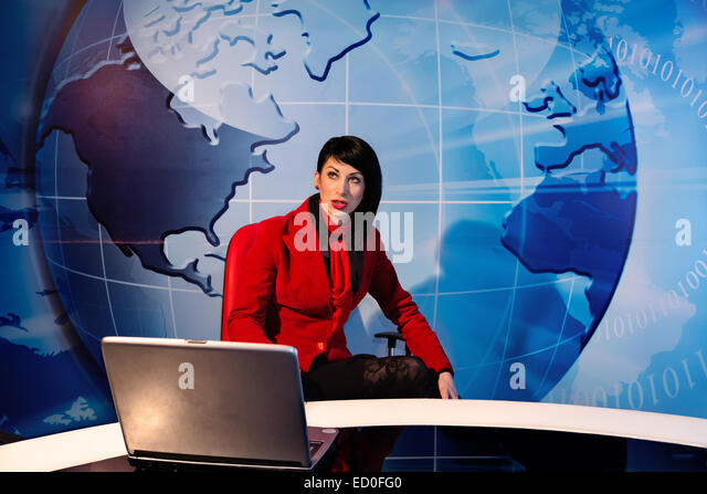 Woman sitting in tv studio - Stock Image