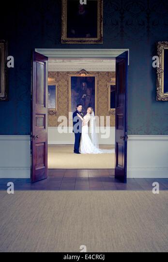 Wedding preparations, Bride and bridegroom in mansion, Dorset, England - Stock-Bilder