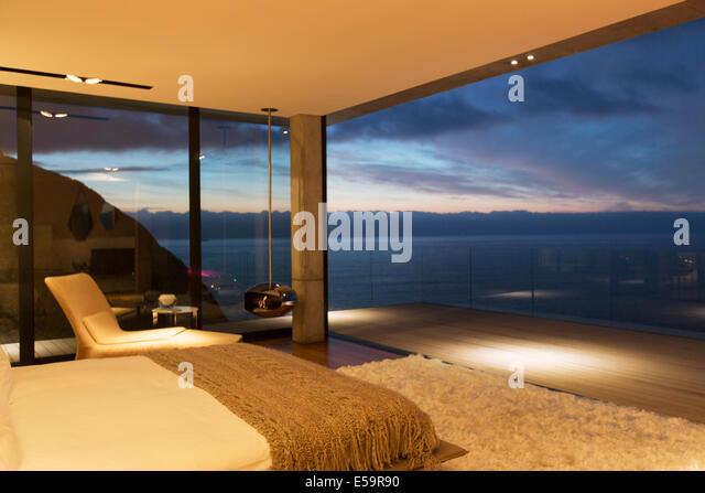Modern bedroom overlooking ocean - Stock Image