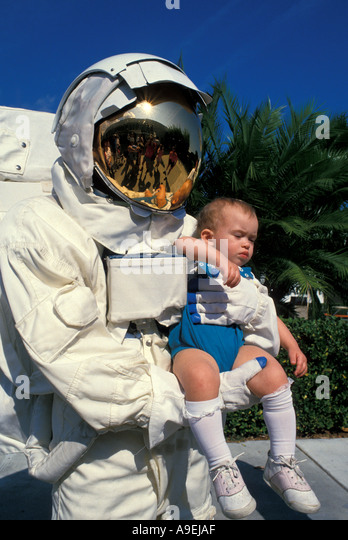 Orlando Florida USA Attractions Kennedy Space Center Titusville Astronaut holding baby - Stock Image