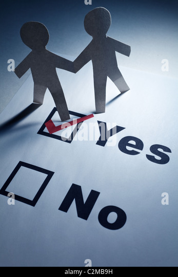 checkbox and Paper Chain Men close up - Stock Image
