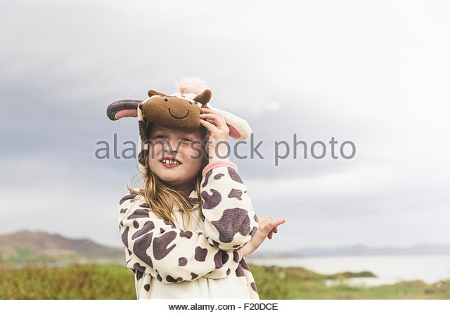 Girl wearing animal onesie with arms folded, Thingvellir, Iceland - Stock Image