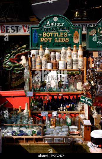 Antique collectable bottles outside Alice's Antiques Shop Portobello Road London March 2009 - Stock Image