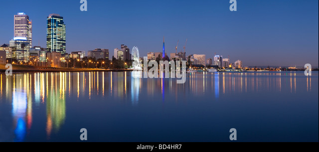 Perth waterfront foreshore reflected in the Swan River at night. - Stock Image